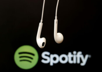 Headphones Are Seen In Front Of A Logo Of Online Music Streaming Service Spotify In This Illustration Picture Taken In Strasbourg
